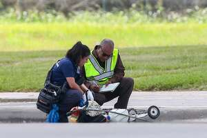 Authorities investigate the scene where a pedestrian was fatally struck by a city garbage truck at the intersection of Gessner Road and Bellaire Boulevard  Monday, Aug. 14, 2017, in Houston.