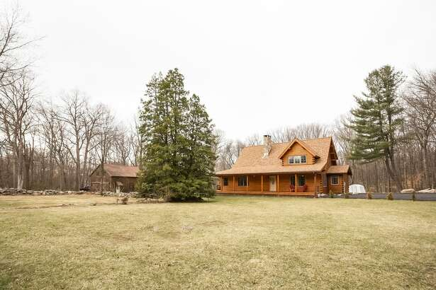 The custom-built Coopersburg log house at 60 Vista Road suits its rural setting in the northwest corner of Wilton and it abuts the Vista Road Open Space, in effect augmenting the properties 2.32 level acres by another 36 acres.