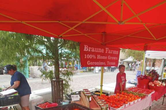 File photo of the Braune Farms vendor sets up for business at the Pearl Farmers Market on Saturday morning on August 5, 2017. The tax bill gave farmers and ranchers an unexpected tax break if they sell to cooperatives instead of companies.