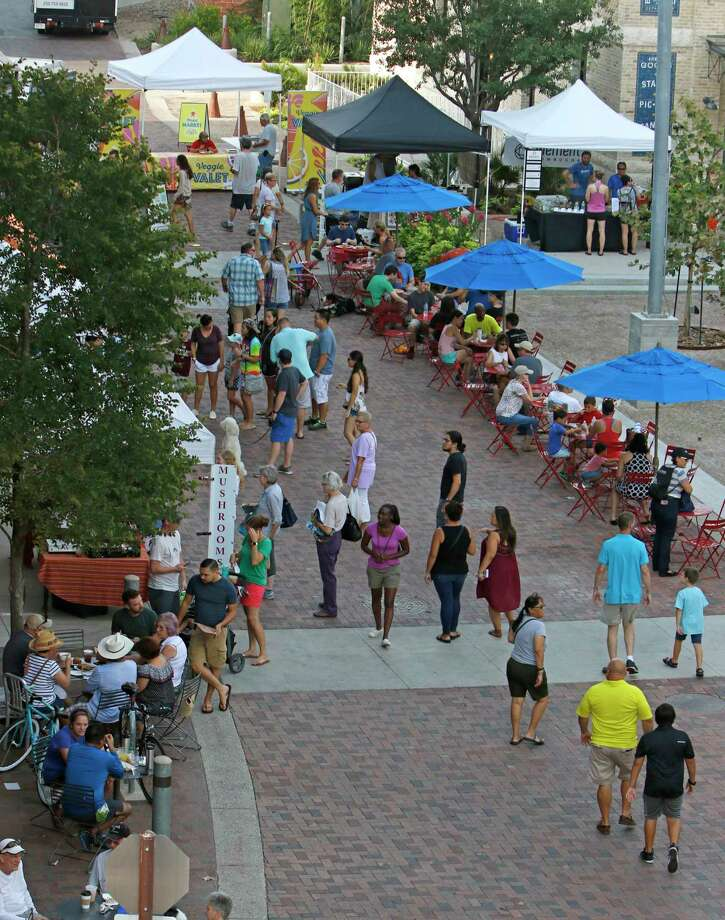San Antonio has seen an explosion of new farmers markets over the past several years. Here, customers shop at the Pearl Farmers Market one recent Saturday morning. Photo: Ron Cortes /For The Express-News / Freelance