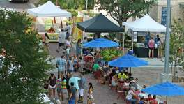 Customers shopping at the Pearl Farmers Market on Saturday morning on Aug. 5, 2017.