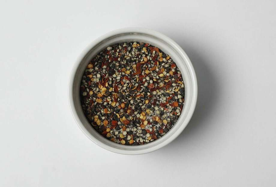 The Classic Central Texas Brisket Rub uses a mixture of equal parts salt and pepper. Add in some crushed red pepper flakes to add a spicy kick. Photo: Kin Man Hui /San Antonio Express-News / ©2017 San Antonio Express-News