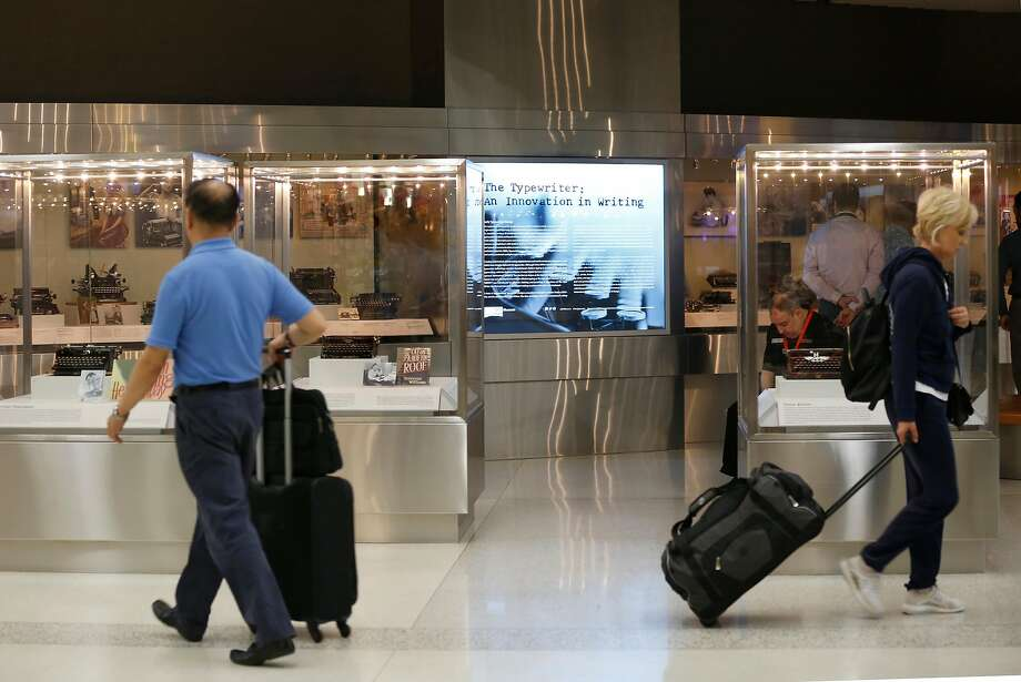A gallery of antique and vintage typewriters is on display in Terminal 2 at San Francisco International Airport. Photo: Liz Hafalia, The Chronicle