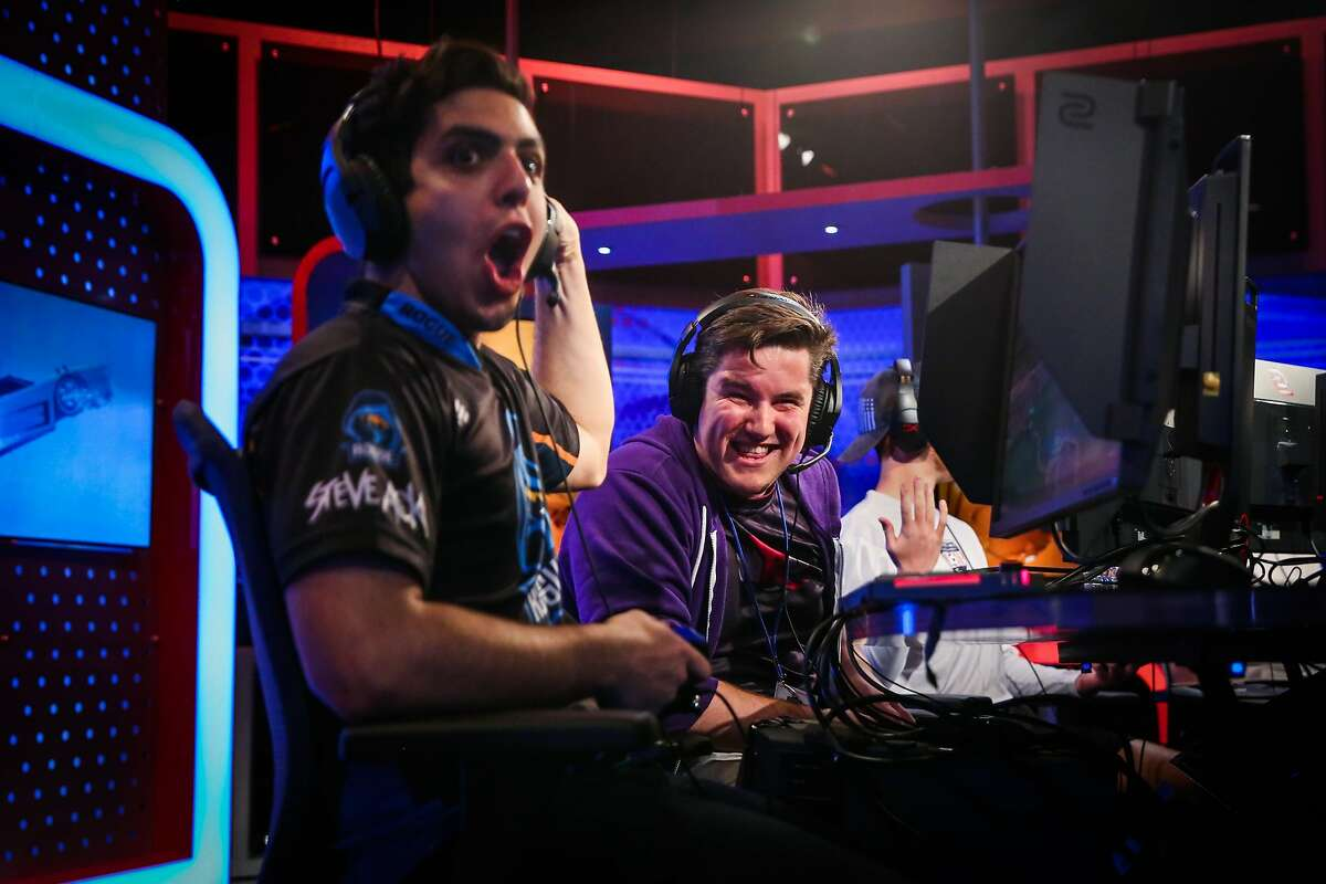 Teammates Emiliano Benny (left) and Jacob McDowell, of team Sizzleurcob react to a play during a televised regional e-sports video game tournament at NBC studios in San Francisco, Calif., on Sunday, Aug. 13, 2017.