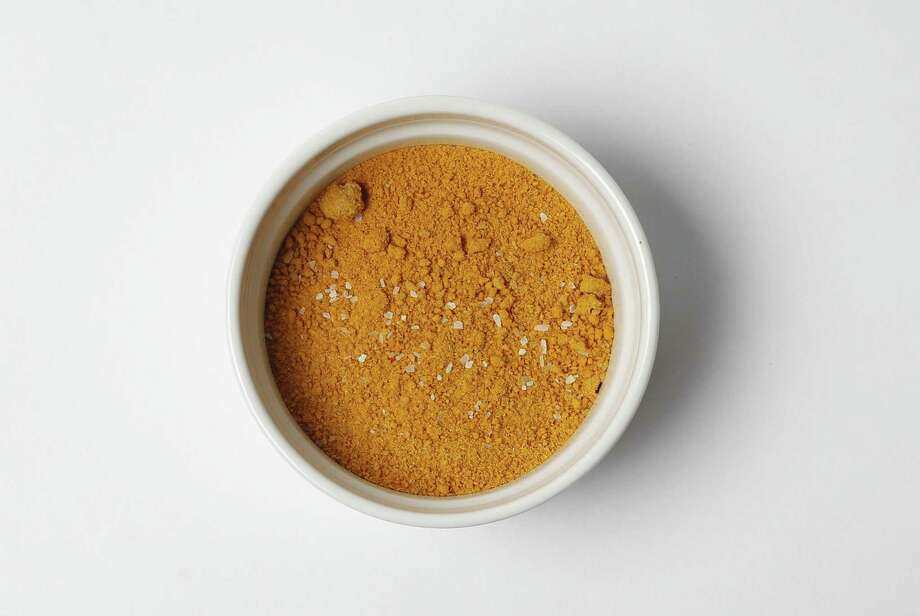 With a heavy dose of healthy turmeric, the Yellow Rub adds a unique flavor profile to pork, chicken and fish. Photo: Kin Man Hui /San Antonio Express-News / ©2017 San Antonio Express-News