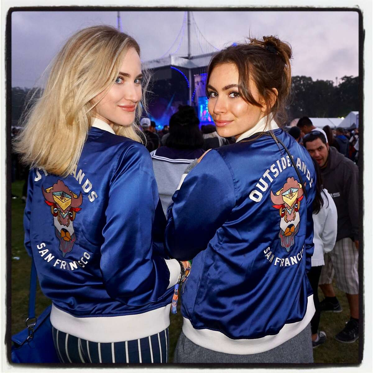 Emily Field (left) and her pal, Sophie Simmons, wearing matching Bison jackets at at Outside Lands. Aug. 11, 2017.