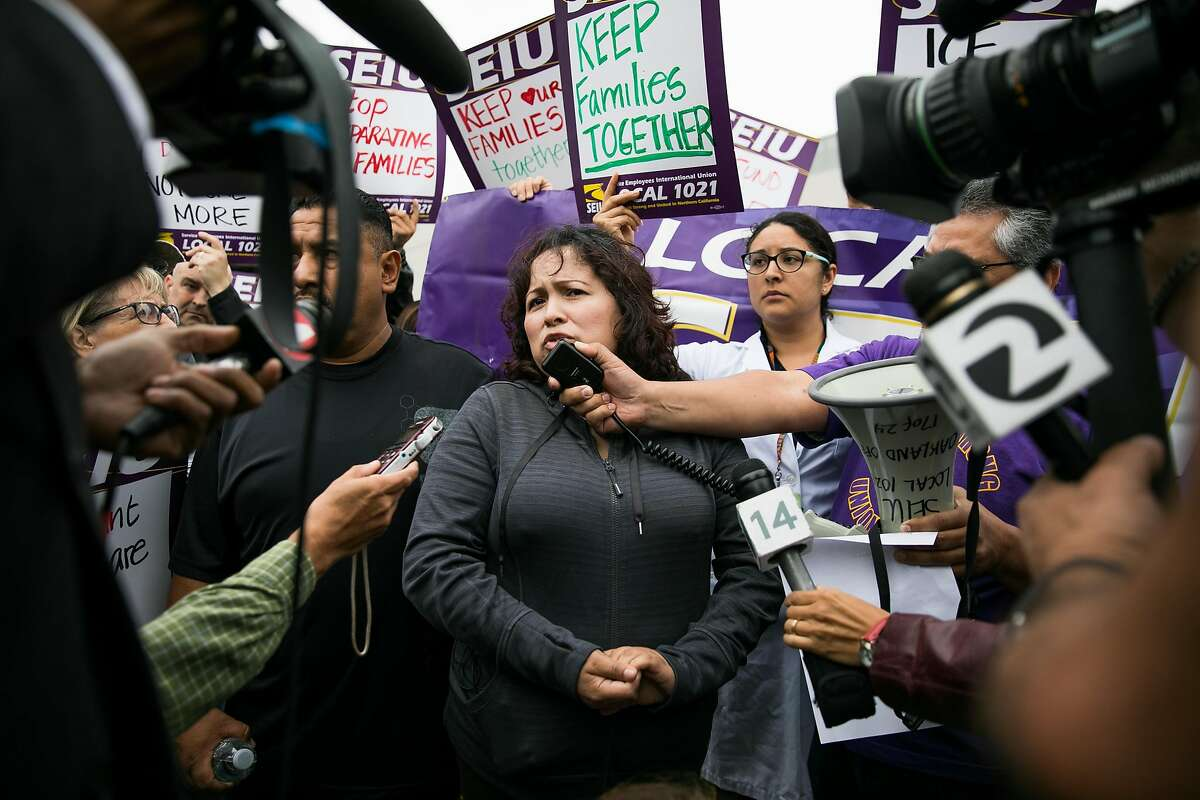 Maria Mendoza-Sanchez, center, speaks to the press as hundreds stand in support of the family at the Highland Hospital in Oakland, Calif. Monday, August 14, 2017.