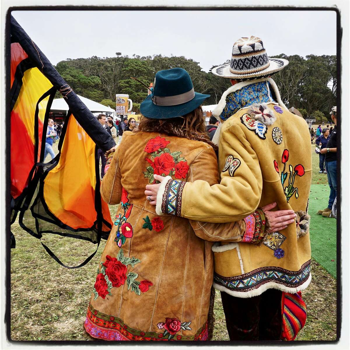 Chelsea Argabrite (left) and Jonathan Bloch wear flea market jackets they hand-embellished at Outside Lands. Aug. 13, 2017.