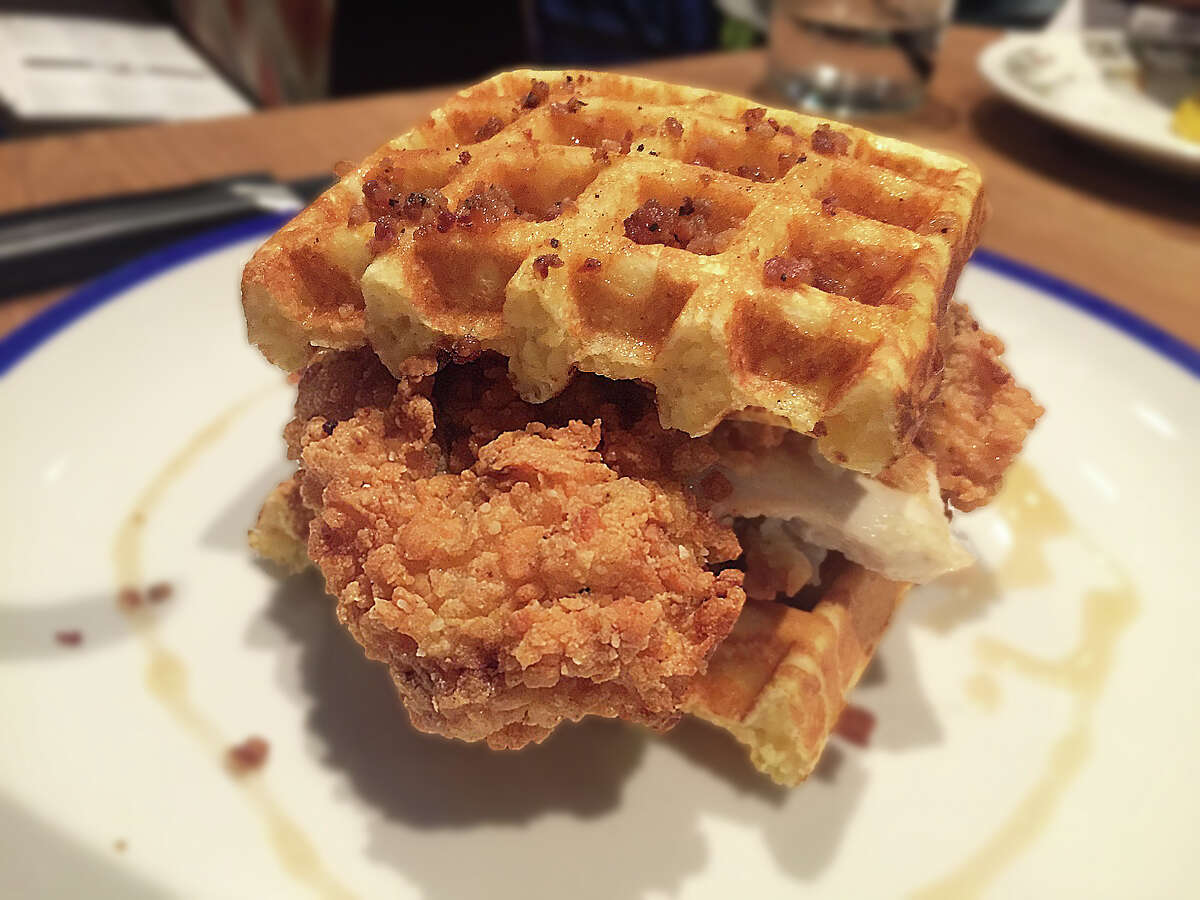Fielding's Rooser is a new casual restaurant in the Woodlands offering a menu of reinterpreted chicken recipes from the owners of Fielding's Wood Grill and Fielding's Local Kitchen & Bar. Shown: Chicken and cornbread waffles with honey, bacon bits and brown butter.