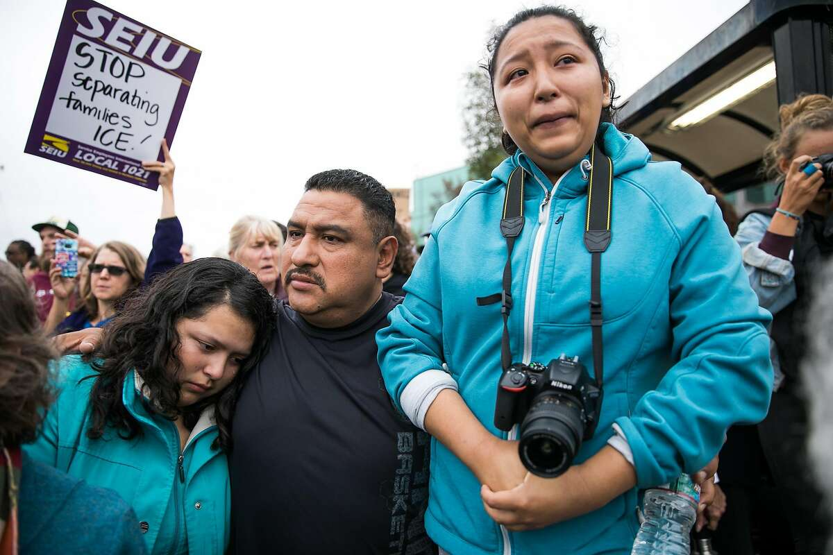 From the left, Elizabeth Sanchez, 16, Eusebio Sanchez, and Melin Sanchez, 21, embrace as hundreds of people chanted in support of the family at the Highland Hospital in Oakland, Calif. Monday, August 14, 2017.