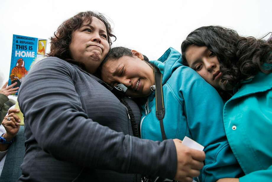 Maria Mendoza-Sanchez comforts her daughters, Melin Sanchez, 21, and Elizabeth Sanchez, 16, at Highland Hospital in Oakland on Monday, August 14, 2017. Photo: Mason Trinca, Special To The Chronicle