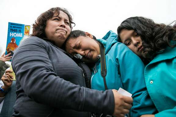 Maria Mendoza-Sanchez comforts her daughters, Melin Sanchez, 21, and Elizabeth Sanchez, 16, at the Highland Hospital in Oakland, Calif. Monday, August 14, 2017.