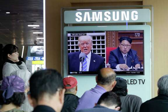 A TV screen shows images of U.S. President Donald Trump, left, and North Korean leader Kim Jong Un during a May news program at the Seoul Railway Station in Seoul, South Korea. (AP Photo/Ahn Young-joon, File)