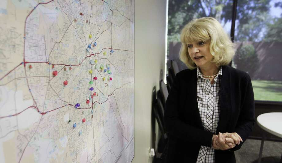 Becky Biser, director of leadership at the Tarrant Baptist Association, checks a map of Fort Worth churches   where  research predicts there's a high risk of child abuse and neglect occurring. Photo: LM Otero / Associated Press / Copyright 2017 The Associated Press. All rights reserved.