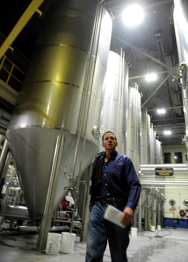 Two Roads Brewery CFO Peter Doering shows the brewery's new energy efficient LED lights have recently been installed on Stratford Avenue in Stratford, Conn. on Wednesday Nov. 2, 2016. The new lights, installed by Digital Lumens, are state-of-the-art, can be controlled via WiFi or from a central computer and have motion sensors. Photo: Christian Abraham / Hearst Connecticut Media / Connecticut Post