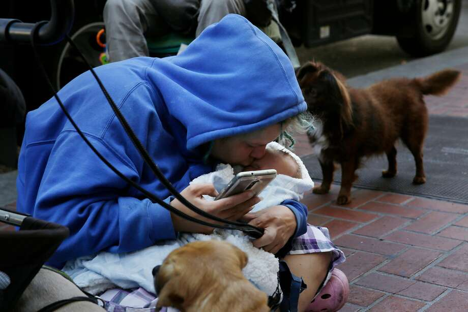Some panhandling moms are not really homeless, unlike Megan Doudney, on Market Street last month with her baby. Photo: Lea Suzuki, The Chronicle