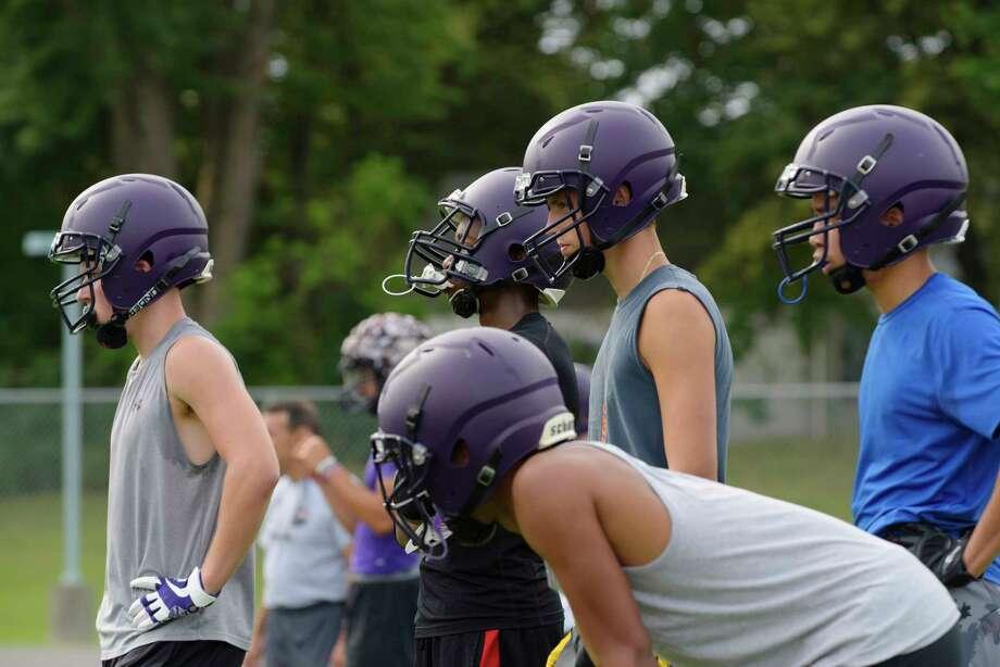 Troy High School football players wait their turn to run through a drill at practice on Monday, Aug. 14, 2017, in Troy, N.Y.  (Paul Buckowski / Times Union) Photo: PAUL BUCKOWSKI / 20041273A