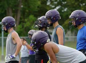 Troy High School football players wait their turn to run through a drill at practice on Monday, Aug. 14, 2017, in Troy, N.Y.  (Paul Buckowski / Times Union)