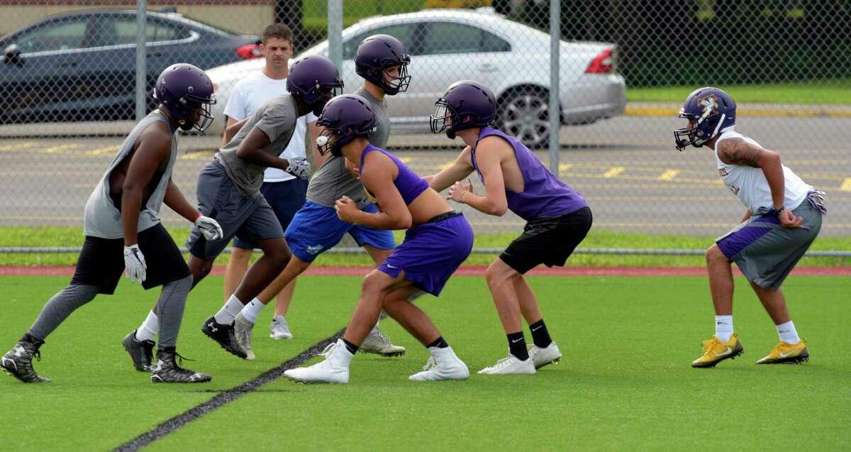 Troy High School football players run through drills at practice on Monday, Aug. 14, 2017, in Troy, N.Y. (Paul Buckowski / Times Union)