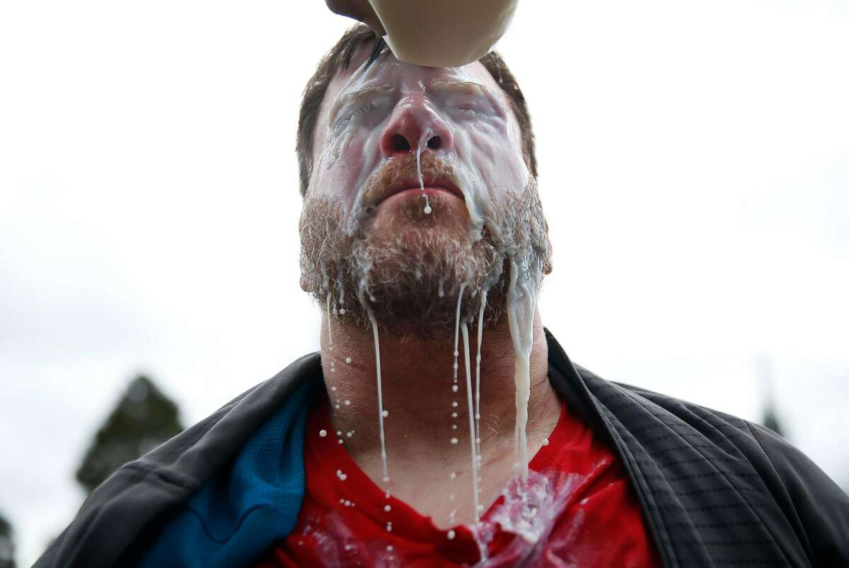 A Trump supporter who preferred not to give his name gets milk poured on his eyes after getting pepper-sprayed during a Pro-President Donald Trump rally and march at the Martin Luther King Jr. Civic Center park March 4, 2017 in Berkeley, Calif.