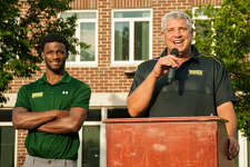 Siena men's basketball coach Jimmy Patsos and player Nico Clareth appear at Siena's Summer Social event, held outside Alumni Recreation Center on Aug. 2, 2017. (Jenn March / Special to the Times Union)
