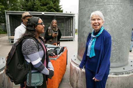 UC Berkeley Chancellor Carol Christ greets incoming freshman, Sarah Hassan, during Move-In Day at UC Berkeley in August 2017. Photo: Mason Trinca / Special To The Chronicle 2017
