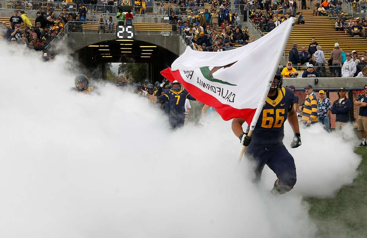 The Cal Bears take the field to square off against the BYU Cougars at Memorial Stadium in Berkeley, Calif. on Saturday, Nov. 29, 2014.