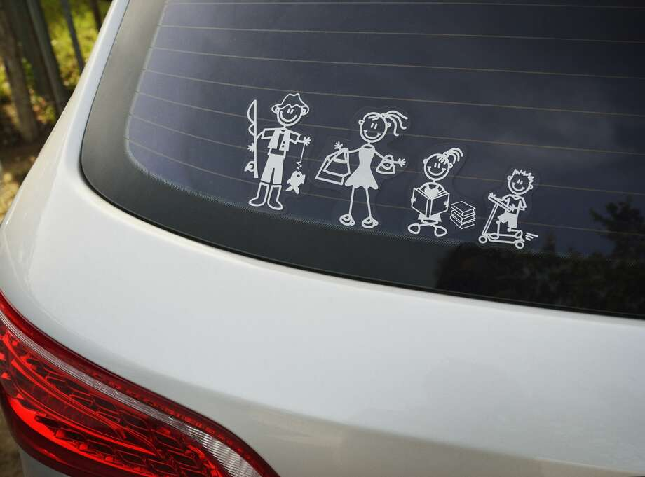 Stick figure family stickers on a car. Photo: David Malan/Getty Images