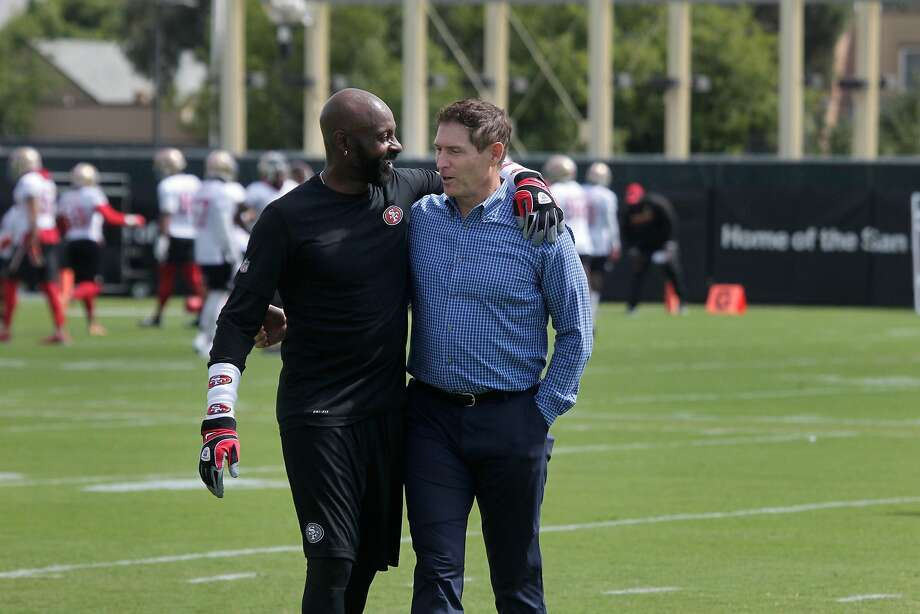 Former 49ers wide receiver Jerry Rice, left, and quarterback Steve Young greet each other during team practice on Monday. The Hall of Famers wanted to help impart a winning attitude. Photo: Lea Suzuki, The Chronicle