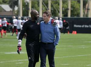Former 49er wide receiver Jerry Rice and quarterback Steve Young greet each other during 49er team practice on Monday, August 14, 2017 in Santa Clara, Calif.