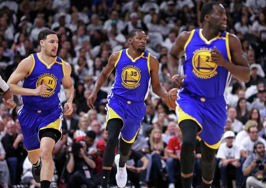 Golden State Warriors' Kevin Durant brings the ball up court flanked by Klay Thompson and Draymond Green in firsst quarter against the Spurs'during Game 3 of NBA Western Conference finals at AT&T Center in on May 20, 2017. Photo: Scott Strazzante /San Francisco Chronicle / **MANDATORY CREDIT FOR PHOTOG AND SF CHRONICLE/NO SALES/MAGS OUT/TV