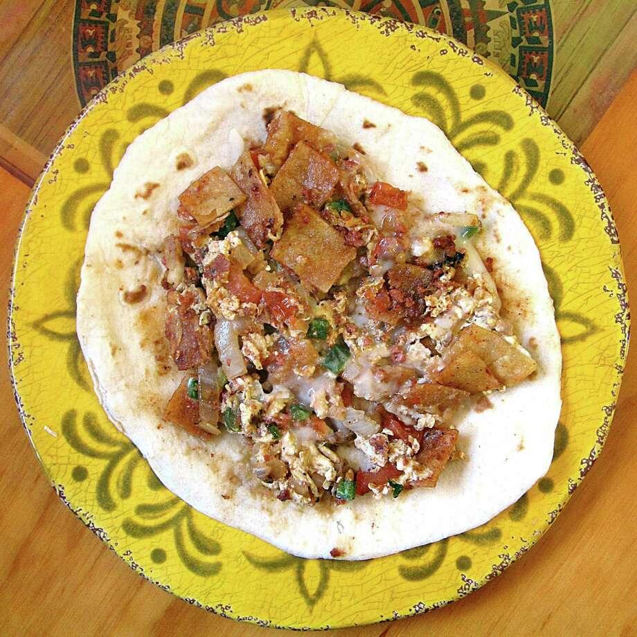 Chori-quiles taco on a handmade flour tortilla from Yatzil Mexican Restaurant. Photo: Mike Sutter /San Antonio Express-News