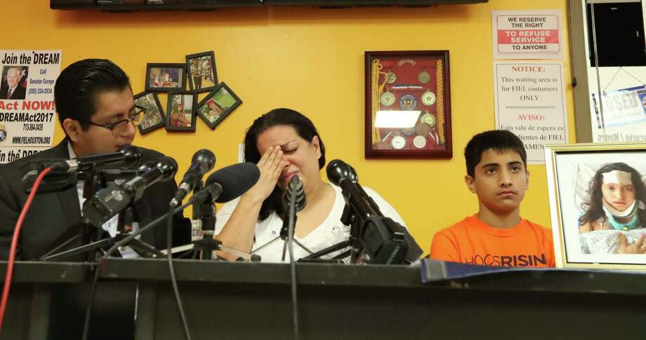 Ericka Chaves (center) is flanked by Cesar Espinosa (left) and her son Sebastian as she talked about her daughter Natalie Romero Monday, Aug. 14, 2017, in Houston.  Romero was amongst those injured in Charlottesville Virginia on August 12, 2017. She has suffered extensive injuries including a fractured skull. It is the mother's wish that her daughter may return home so she can look after her daughter. Photo: Steve Gonzales, Houston Chronicle / © 2017 Houston Chronicle