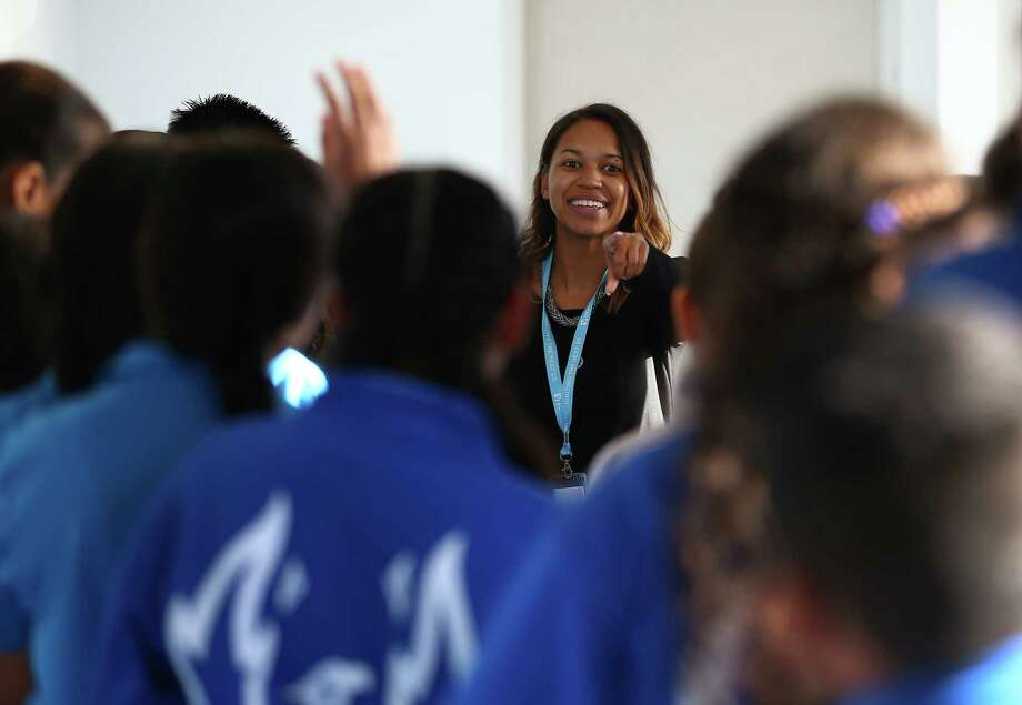 Houston's children and families were eager to get back to learning and reestablish a sense of normalcy after Harvey. In this photo: YES Prep Northline school counselor Lenette Battle interacts with students during a tour of the newly opened school. Photo: Godofredo A. Vasquez, Houston Chronicle / Godofredo A. Vasquez