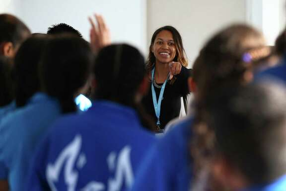 YES Prep Northline school counselor Lenette Battle, center, interacts with students during a tour of the new school, YES Prep Northline, Monday, Aug. 14, 2017, in Houston. The school used to be a hospital less than six months ago, and welcomed its inaugural class made up of 157 sixth-grade students.