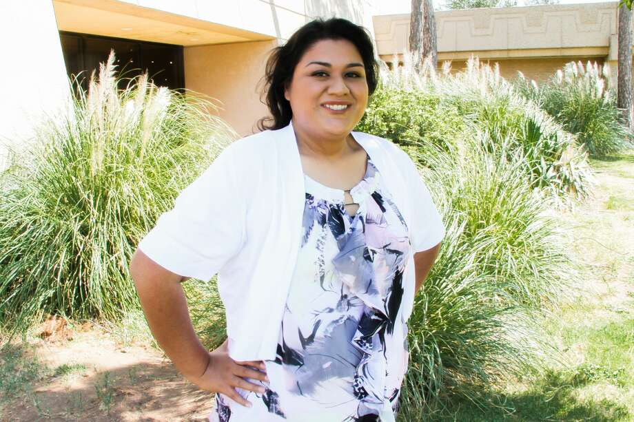 Irma Bueno credits her parents, siblings, friends and MC employees with giving her the love and encouragement to continue that last semester.  Photo: Katherine Curry