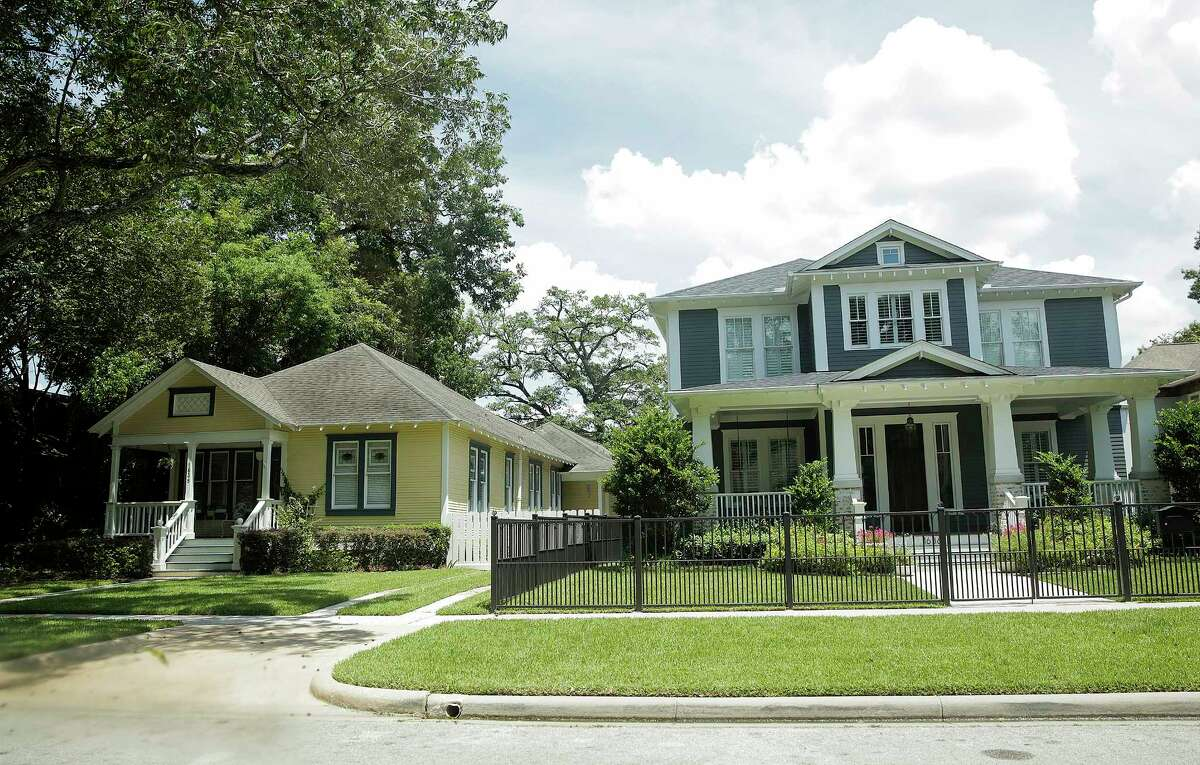 Today's approval process in the Historic Heights neighborhoodaims to keep larger homes from overwhelming smaller ones. See the Heights through the years.
