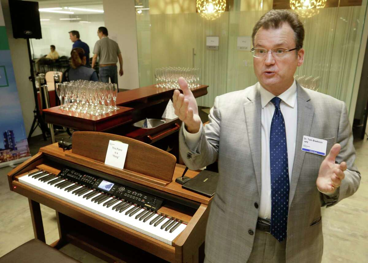 Tom Bradicich, a general manager and vice president at Hewlett Packard Enterprise, talks at Hewlett Packard Enterprise, 27816 Jones Rd., about the piano bar that is part of HPE's Internet of Things Innovation Lab Monday, Aug. 14, 2017, in Houston. The piano features voice activation. ( Melissa Phillip / Houston Chronicle )