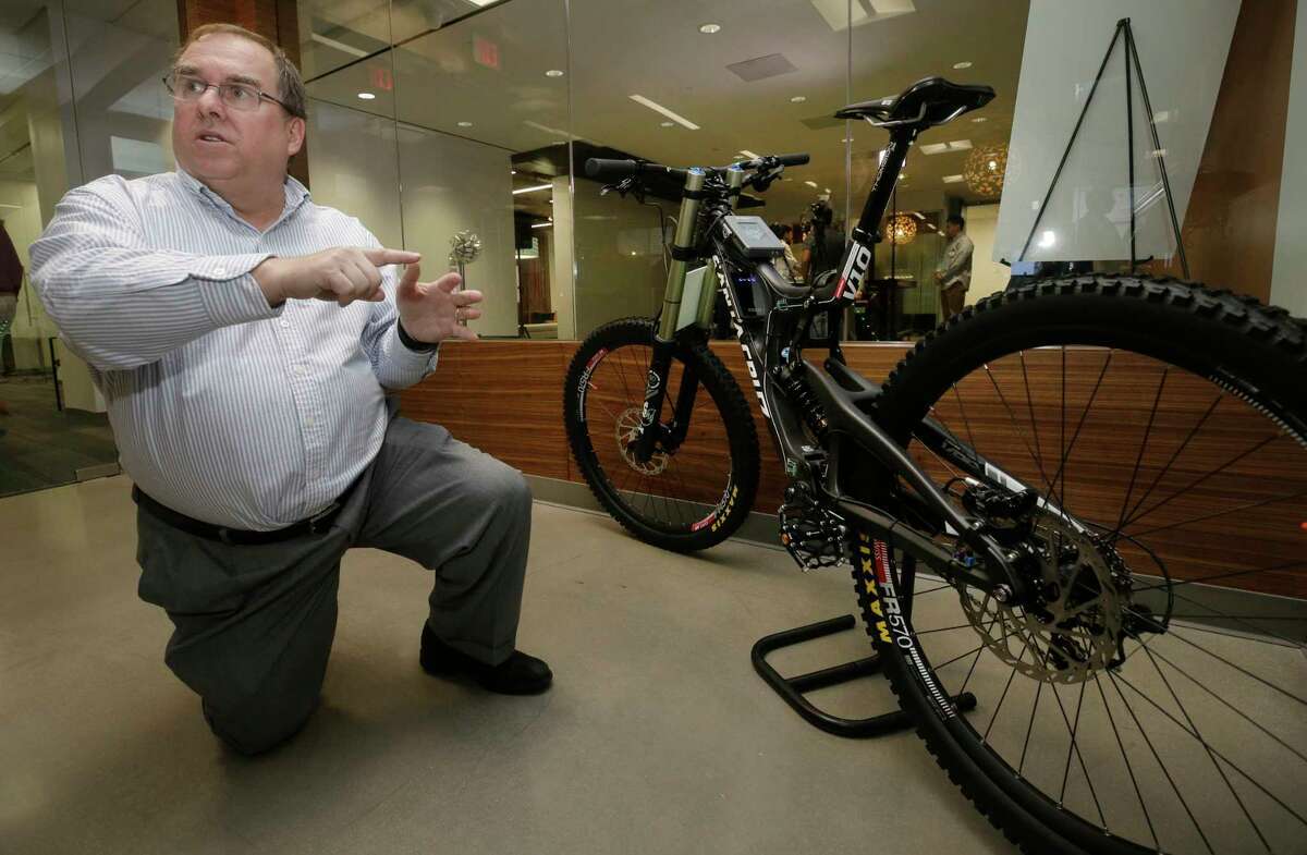 Ron Neyland, senior director of Internet of Things software and solutions, talks at Hewlett Packard Enterprise, 27816 Jones Rd., about a mountain bike exhibit shown during a tour at HPE's Internet of Things Innovation Lab Monday, Aug. 14, 2017, in Houston. He talked about how data senors can be used on products under design to tweak the designs before mass production. ( Melissa Phillip / Houston Chronicle )