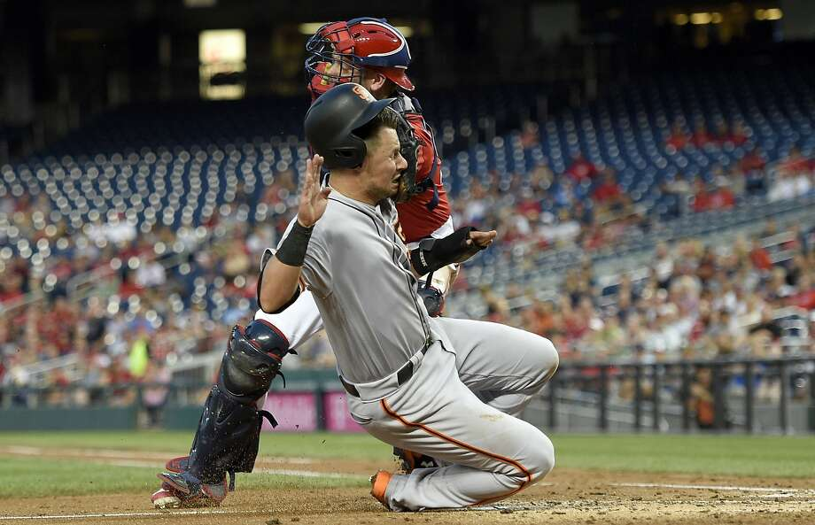 San Francisco Giants' Joe Panik, foreground, is tagged out by Washington Nationals catcher Matt Wieters during the fourth inning of the second baseball game of a split doubleheader, Sunday, Aug. 13, 2017, in Washington.  Photo: Nick Wass, Associated Press