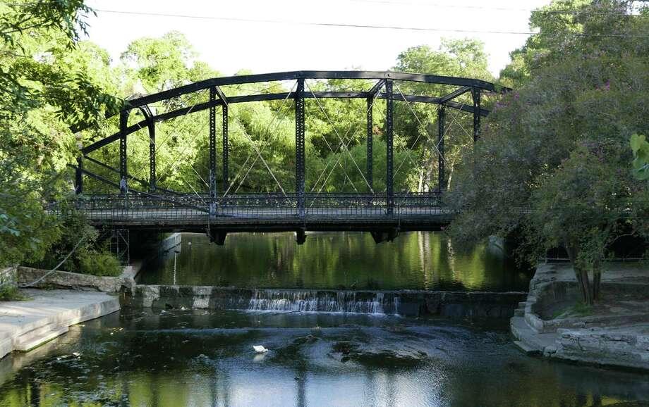 The Brackenridge Park Bridge was built in 1890 by the Berlin Iron Bridge Co. of East Berlin, Conn. It's one of several historic iron bridges still being used in San Antonio. Photo: Billy Calzada /San Antonio Express-News / San Antonio Express-News