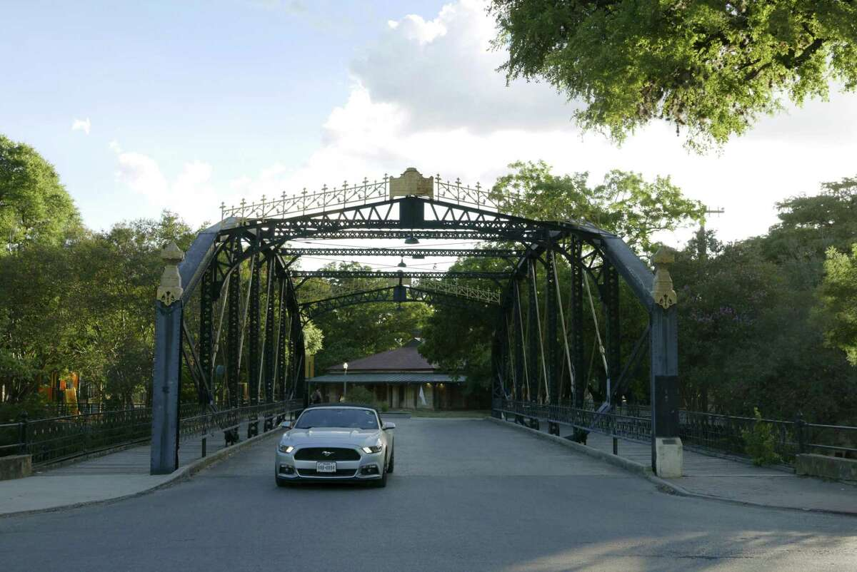 A car drives over the Brackenridge Park Bridge, which was built in 1890 by the Berlin Iron Bridge Co. of East Berlin, Conn. The city of San Antonio has several iron bridges over the San Antonio River.