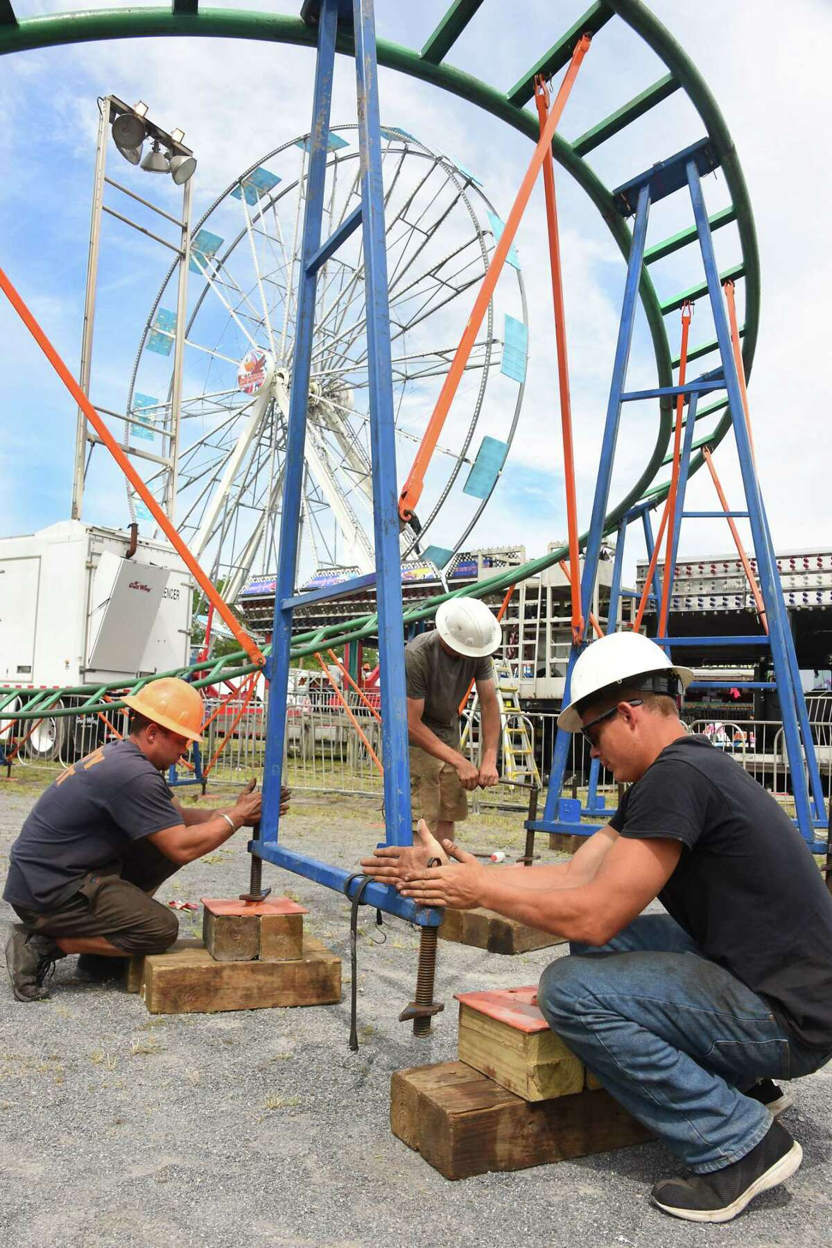 Fair workers set up for opening day tomorrow at the Altamont Fair Monday, Aug. 14, 2017 in Altamont, N.Y. (Lori Van Buren / Times Union)
