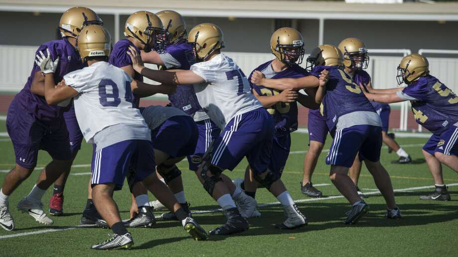 Midland High players run drills 8/14/17 evening for the first day of practice.Click through to meet the 2017 Midland High team. Photo: Tim Fischer/Midland Reporter-Telegram