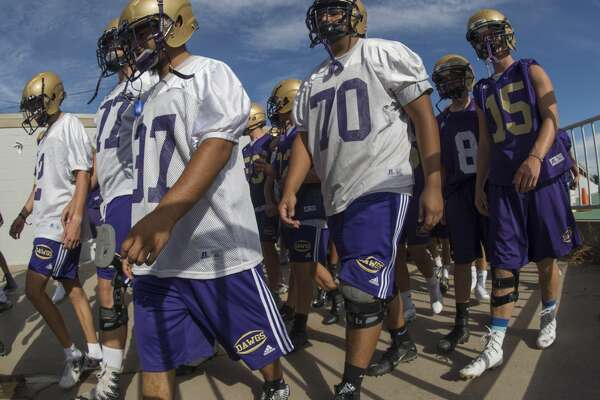 Midland High players make their way onto the field at Memorial Stadium 8/14/17 evening for the first day of practice. Tim Fischer/Reporter-Telegram