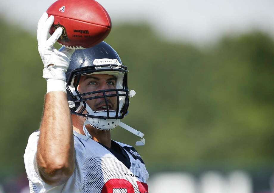 Houston Texans tight end C.J. Fiedorowicz makes a one-handed catch before practice during training camp at The Greenbrier on Aug. 3, 2017, in White Sulphur Springs, W.Va. Photo: Brett Coomer /Houston Chronicle / © 2017 Houston Chronicle}