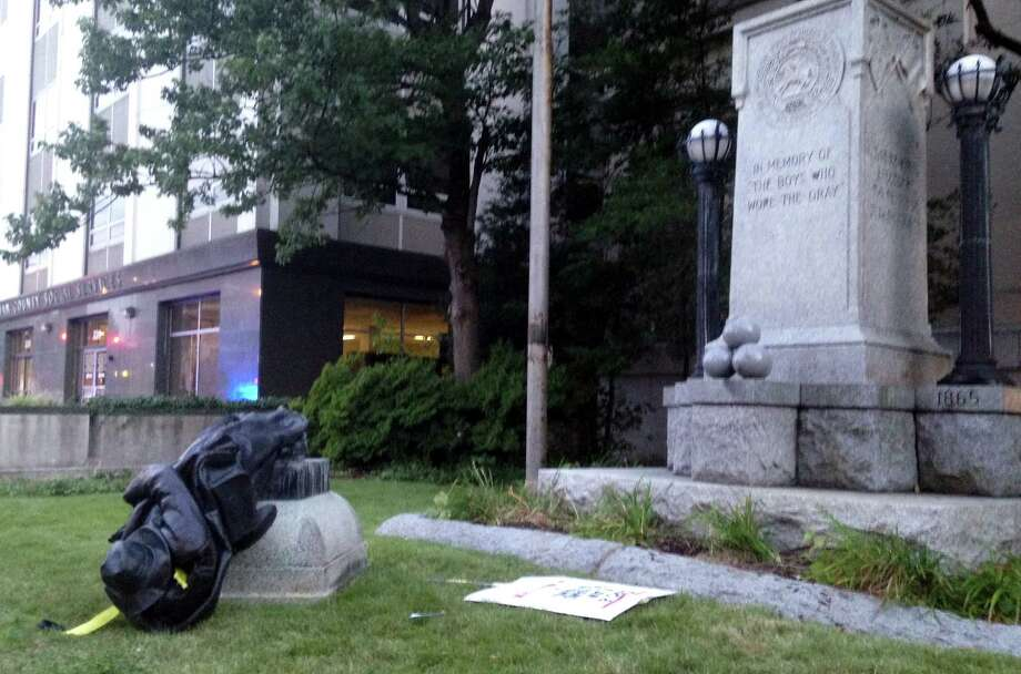 Protestors tied a rope around and toppled a Confederate statue on Monday, Aug. 14, 2017, in Durham, N.C. Photo: Jonathan Drew, Associated Press / ap