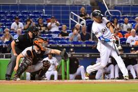 MIAMI, FL - AUGUST 14: Giancarlo Stanton #27 of the Miami Marlins hits his 43rd homer of the season in the first inning against the San Francisco Giants at Marlins Park on August 14, 2017 in Miami, Florida. (Photo by Eric Espada/Getty Images)