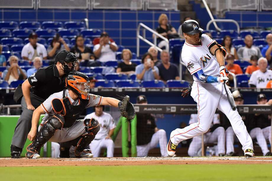 Giancarlo Stanton of the Miami Marlins hits his 43rd homer of the season in the first inning against the San Francisco Giants at Marlins Park on August 14, 2017 in Miami, Florida. Photo: Eric Espada, Getty Images