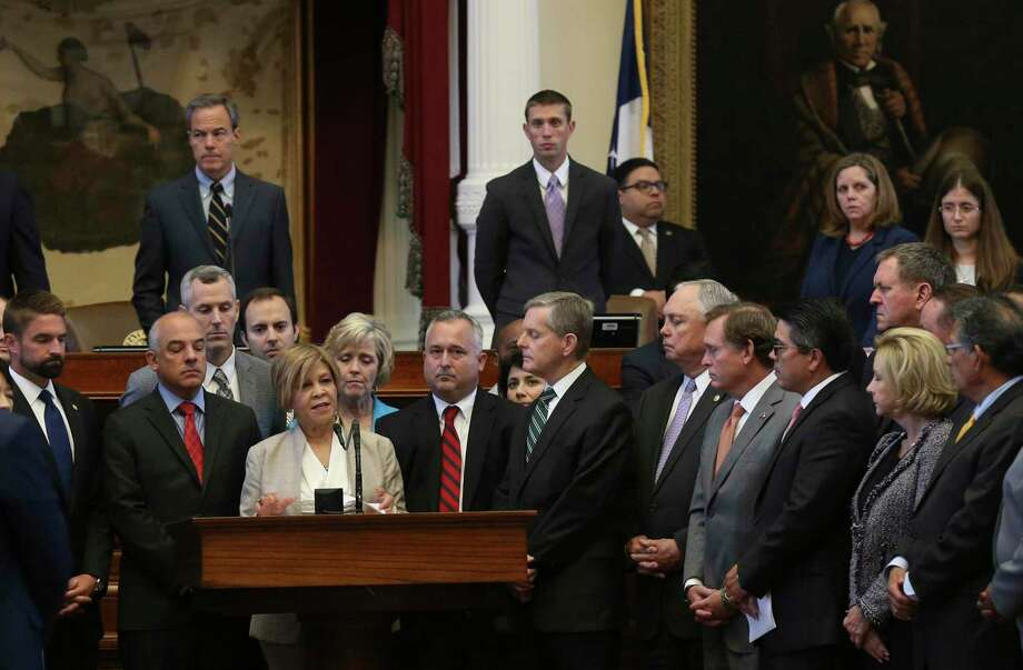 Surrounded by colleagues, Texas State Rep. Helen Giddings, D-Desoto, memorializes  the victims of the Charlottesville violence during the Special Session, Monday, August 14, 2017. She also denounced the racism on display at the event in Charlottesville. Photo: JERRY LARA / San Antonio Express-News / San Antonio Express-News